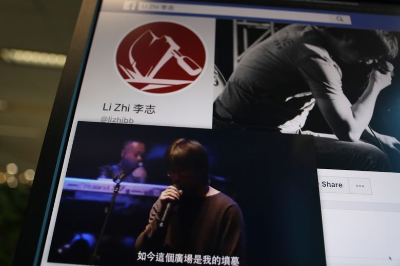 """In this May 30, 2019, photo, a computer screen shows web content from outside China including a clip of Chinese singer Li Zhi singing his song """"The Square"""" with the lyrics """"Now this square is my grave"""" and his social media site in Beijing on. Li is an outspoken artist who performs """"folk-rock."""" He sang pensive ballads about social ills, and unlike most entertainers in China, he dared to broach the taboo subject of the Tiananmen Square pro-democracy protests that ended in bloodshed on June 4, 1989. (AP Photo/Ng Han Guan)"""