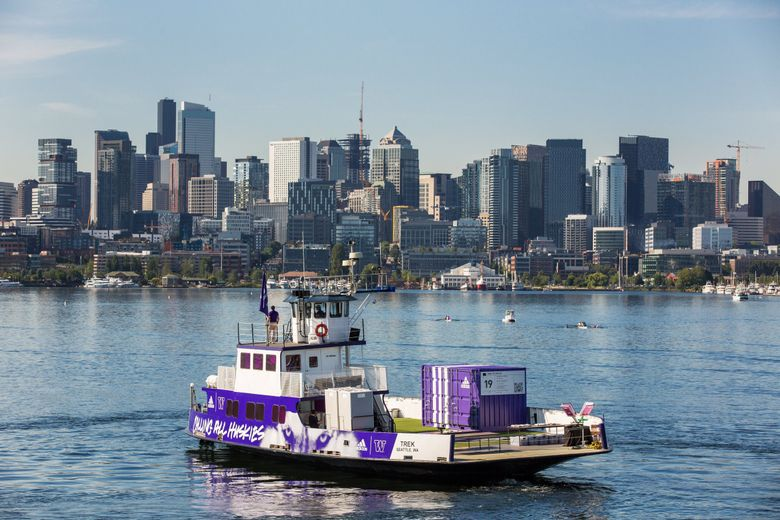 """""""UW's """"PartnerShip"""" boat cruises around Lake Union on Monday, July 1.  (Dan DeLong / Red Box Pictures)"""