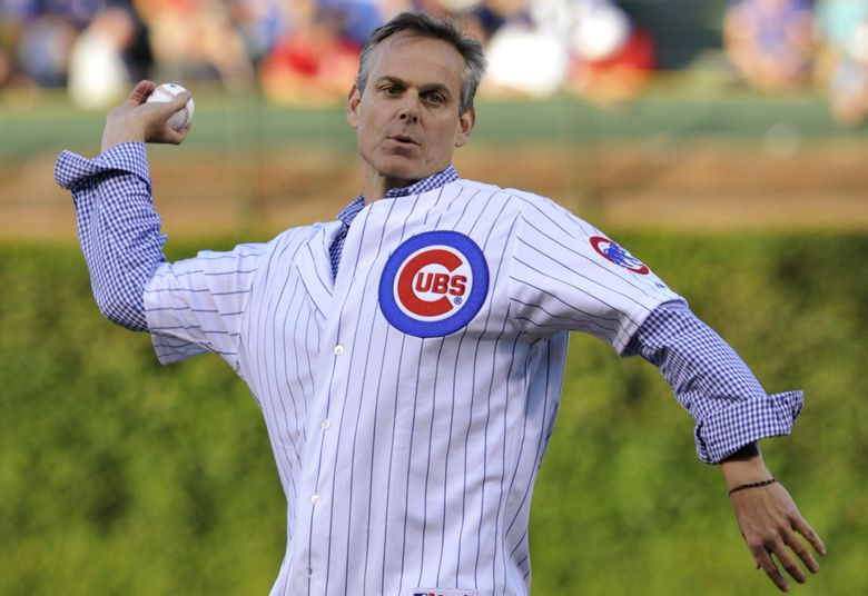 Colin Cowherd tosses out the first pitch at a Chicago Cubs game in 2013. (Jim Prisching / AP)