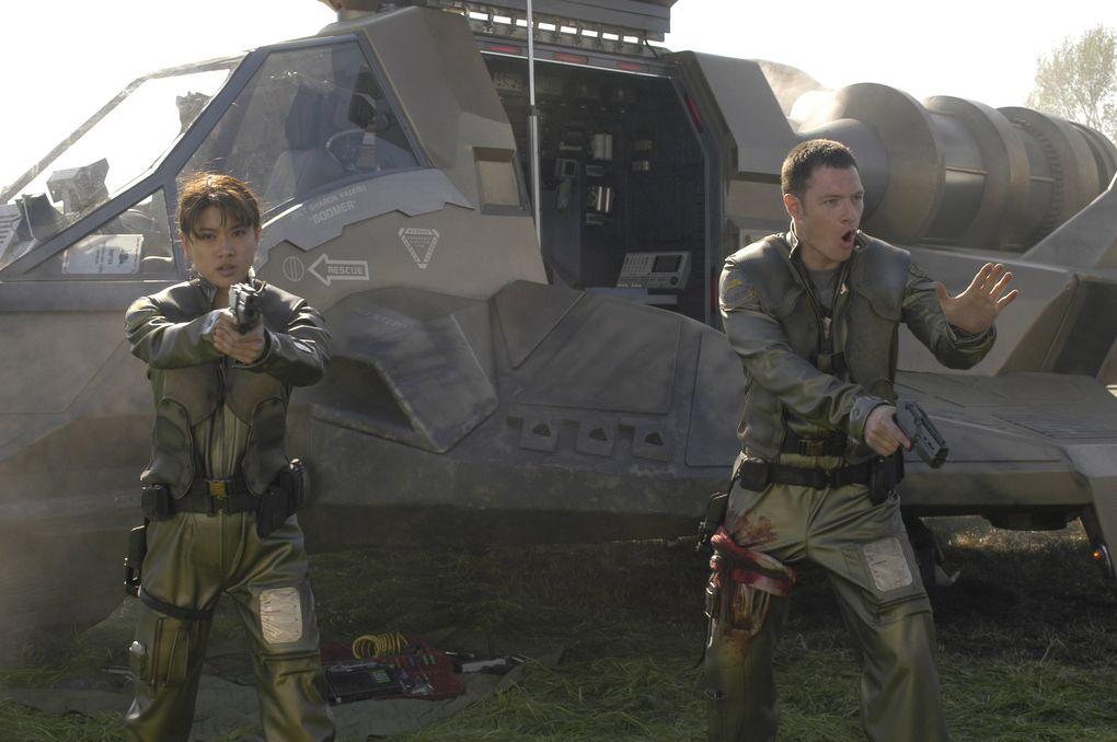 """Grace Park and Tahmoh Penikett in """"Battlestar Galactica."""" (Alan Zenuk / Sci-Fi Channel)"""