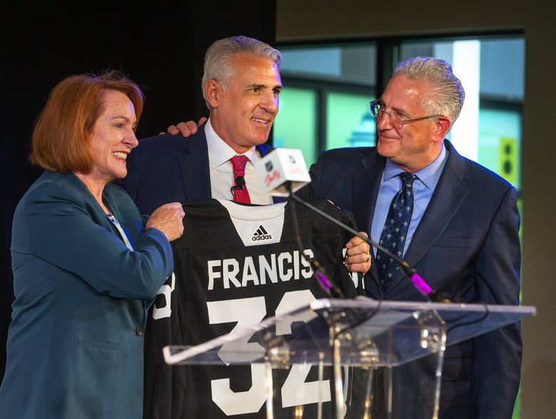 Ron Francis, new GM of Seattle's future NHL franchise, center, is introduced to Seattle media by Mayor Jenny Durkan, left, and NHL Seattle president and CEO Tod Leiweke in July. (Mike Siegel / The Seattle Times)