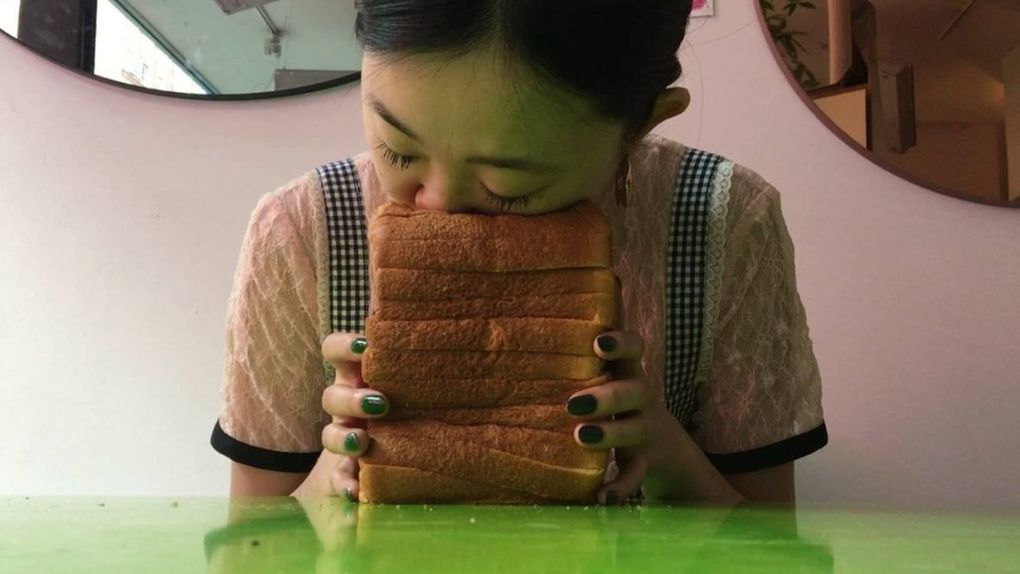 Brooklyn-based Bread Face, who has amassed a social-media following for smashing her face into bread, will have an interactive installation at Seattle Art Fair. People will be invited to touch and play with bread products, which will then be placed on display. (Bread Face)