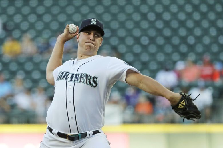 Seattle Mariners opening pitcher Erik Swanson throws against the Detroit Tigers during the first inning of a baseball game, Thursday, July 25, 2019, in Seattle.  (Ted S. Warren / The Associated Press)