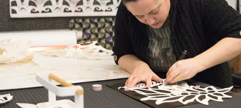 Celeste Cooning, Amazon's first artist in residence, specializes in cut-paper installation pieces. (Courtesy of Amazon)