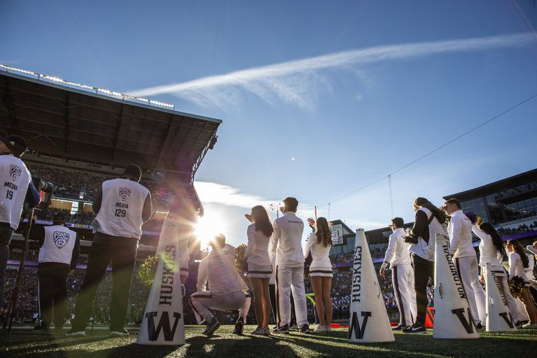 A brilliant sky greets fans at Husky Stadium before a Pac-12 football game. (Dean Rutz / The Seattle Times)