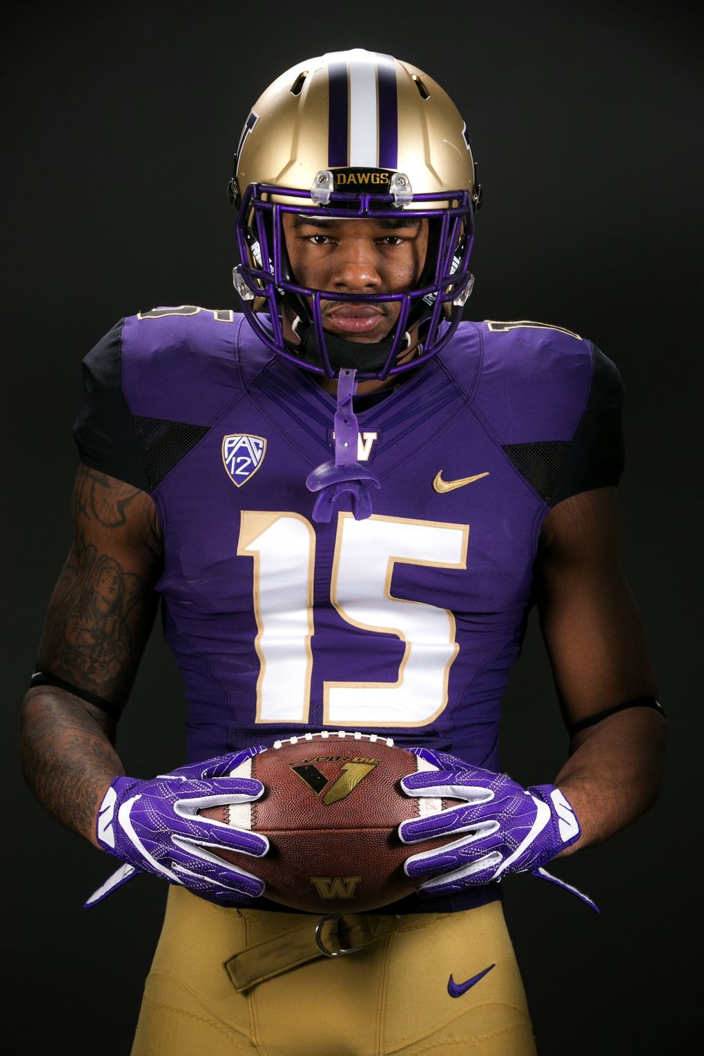 A look at the UW uniforms in 2016. Shot in Seattle Times photo studio Wednesday February 17, 2016. (Bettina Hansen / The Seattle Times)
