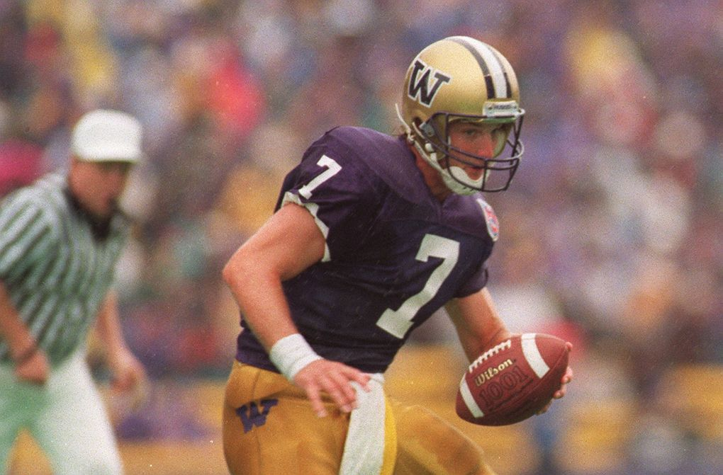 Damon Huard hands the ball off in 1994. (Rod Mar / The Seattle Times)