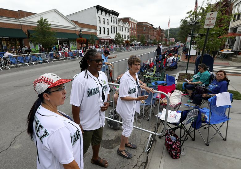 From left Amy Franz of Auburn, Linda Cooper of Olympia and Becky Mulhollen of Snohomish hang out together on Main Street Saturday, July 20, 2019 in Cooperstown, New York. The three are all season ticket holders who sit near each other at Mariners games. (Ken Lambert / The Seattle Times)