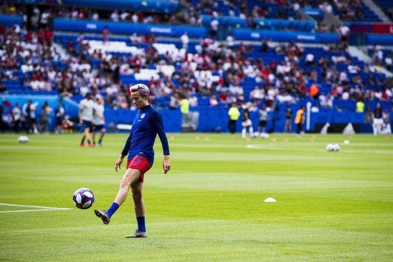 U.S. forward Megan Rapinoe (15), who was out with an injury, juggles a soccer ball before the Women's World Cup semifinal match between the U.S. and England at Stade de Lyon in Lyon, France, July 2, 2019. (Pete Kiehart/The New York Times)