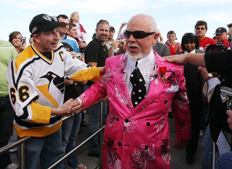 """Don Cherry, fired Monday as an announcer on """"Hockey Night in Canada,"""" is greeted by fans as he arrives for Game 2 of the NHL hockey Stanley Cup finals between the Pittsburgh Penguins and the Detroit Red Wings in Detroit, Sunday, May 31, 2009. (Carlos Osorio / ASSOCIATED PRESS)"""