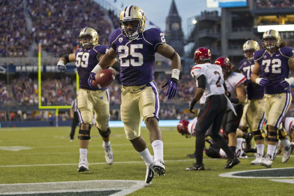 Washington's Bishop Sankey rumbles into the end zone in 2012. (Dean Rutz / The Seattle Times)