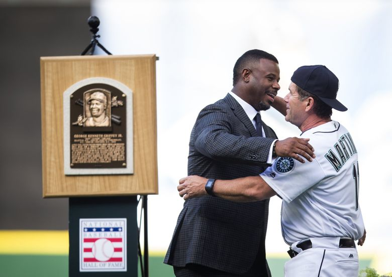 Ken Griffey Jr. greets former teammate Edgar Martinez during a pregame ceremony to retire the Griffey's jersey number at Safeco Field on Aug. 6, 2016. (Lindsey Wasson / The Seattle Times)