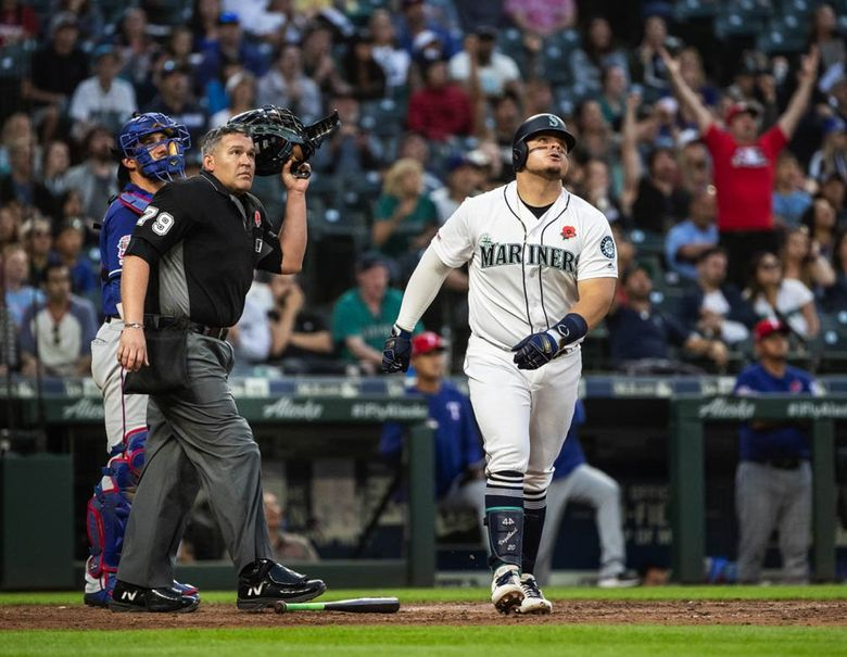 Mariners first baseman Daniel Vogelbach watches a home run soar over the left-field fence against the Rangers on Monday, May 27, 2019 at T-Mobile Park. (Dean Rutz / The Seattle Times)