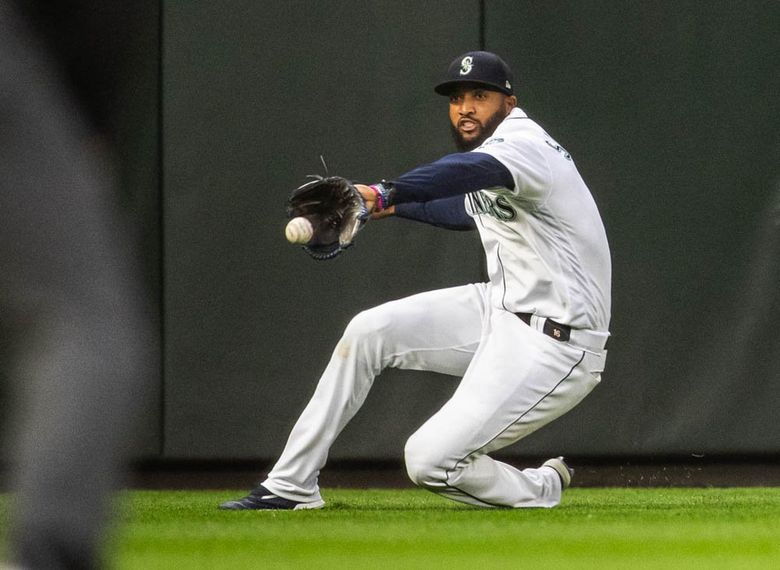 Seattle left fielder Domingo Santana sees the shot from Minnesota's Miguel Sano go off his glove for a double in the fourth inning during a game in May at T-Mobile Park. (Dean Rutz / The Seattle Times)
