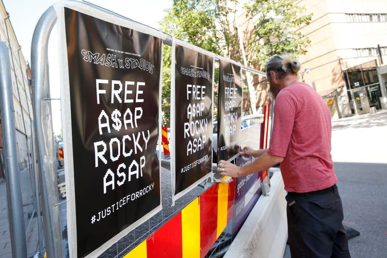 A man displays posters in support of US rapper A$AP Rocky, real name Rakim Mayers, outside the Kronoberg custody in Stockholm, Sweden, Thursday,  July 25, 2019. A Swedish prosecutor on Thursday charged rapper A$AP Rocky, with assault over a fight in Stockholm last month, in a case that's drawn the attention of fellow recording artists as well as U.S. President Donald Trump. (Fredrik Persson/TT News Agency via AP)