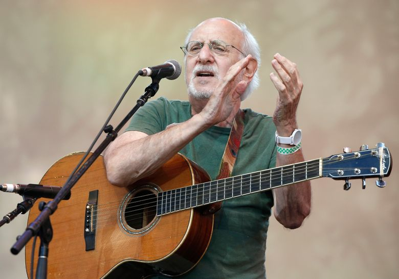 """FILE – In this July 20, 2014, file photo, singer-songwriter Peter Yarrow, of the 1960's era musical trio """"Peter Paul and Mary,"""" claps and encourages the audience to sing along during a memorial tribute concert for folk icon and civil rights activist Pete Seeger at Lincoln Center's Damrosch Park in New York. An upstate New York music festival has disinvited folk singer Peter Yarrow of Peter, Paul and Mary over his 1970 jail sentence for indecent liberties with a 14-year-old girl. The Press and Sun Bulletin of Binghamton reports that board members of the Colorscape Chenango Arts Festival in upstate New York cited negative reaction to Yarrow on social media in their decision to remove Yarrow from the festival's lineup.  (AP Photo/Kathy Willens, File)"""