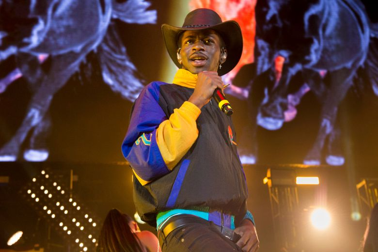 """FILE – This June 1, 2019 file photo shows Lil Nas X performing at HOT 97 Summer Jam 2019 in East Rutherford, N.J. The rapper has taken his """"Old Town Road"""" to the top of the Billboard charts for 16 weeks, tying a record set by Mariah Carey and Luis Fonsi. (Photo by Scott Roth/Invision/AP, File)"""