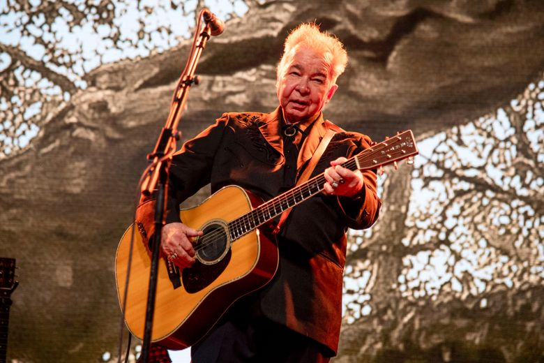 FILE – This June 15, 2019 file photo shows John Prine performing at the Bonnaroo Music and Arts Festival in Manchester, Tenn. Prine is postponing several shows this summer as he plans to have surgery to insert a stent to prevent a stroke. (Photo by Amy Harris/Invision/AP, File)