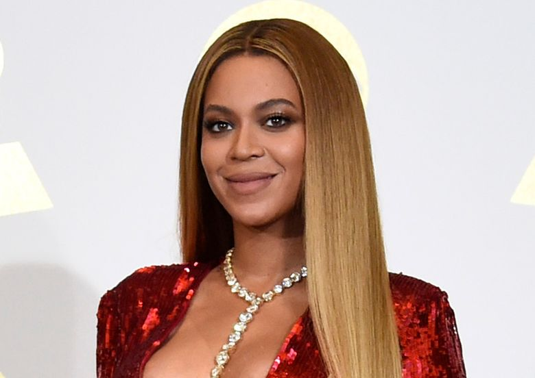 """FILE – In this Feb. 12, 2017 file photo, Beyonce poses in the press room at the 59th annual Grammy Awards in Los Angeles. Beyonce is dropping a new original song from Disney's live-action """"Lion King."""" The song, """"Spirit,"""" will be released later Tuesday, July 9, 2019, and should get a push for Academy Award consideration. (Photo by Chris Pizzello/Invision/AP, File)"""