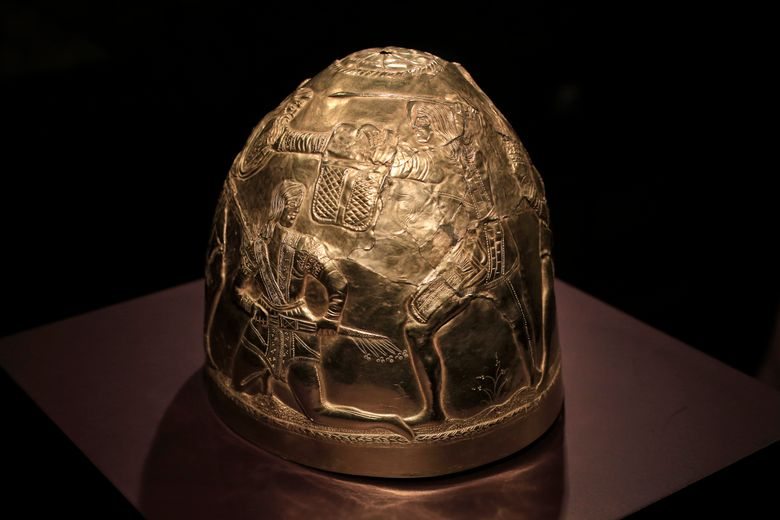"""FILE – In this Friday April 4, 2014 file photo, a Scythian gold helmet from the fourth century B.C. is displayed as part of the exhibit called The Crimea – Gold and Secrets of the Black Sea, at Allard Pierson historical museum in Amsterdam. An appeals court in Amsterdam says it needs more time to rule on the ownership of a valuable trove of historical artefacts loaned to a Dutch museum by four museums in Crimea shortly before the region's 2014 annexation by Russia. In an interim ruling on Tuesday, July 16, 2019, the Amsterdam Court of Appeal says it needs """"greater clarity"""" on the competing claims by Ukraine and the museums in Crimea. (AP Photo/Peter Dejong, file)"""