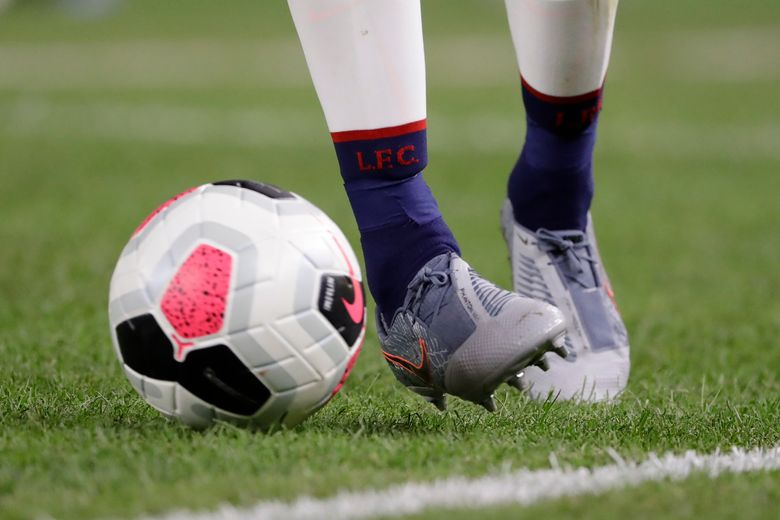 Liverpool FC's James Milner kicks the ball during the second half of a soccer match against the Sporting CP Wednesday, July 24, 2019, in New York. The game ended 2-2. (AP Photo/Frank Franklin II)