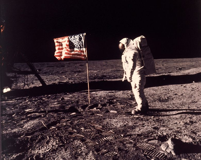 Buzz Aldrin poses for a photograph beside the U.S. flag deployed on the moon during the Apollo 11 mission on July 20, 1969.  (Neil. Armstrong/NASA, 1969)