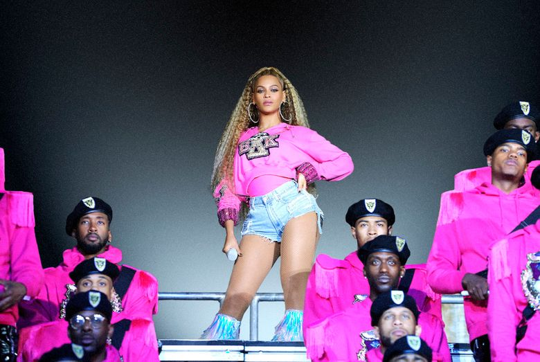 """This image released by Netflix shows Beyonce in a scene from her documentary """"Homecoming: A Film by Beyoncé."""" Beyoncé,""""  earned four Emmy nominations Tuesday, including bids for producing, writing, co-directing and musical direction.  (Parkwood Entertainment/Netflix via AP)"""