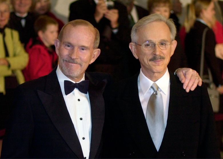 FILE – This Oct. 29, 2002 file photo shows The Smothers Brothers, Tom Smothers, left, and Dick Smothers at the Kennedy Center in Washington for the Mark Twain Prize for Humor Award ceremony honoring Bob Newhart. The duo has stepped out of retirement to commemorate the day 50 years ago when CBS canceled their show over their political impudence. The pair reunited Monday, July 29, 2019, for several appearances at the National Comedy Center in Jamestown, New York. (AP Photo/Lawrence Jackson, File)