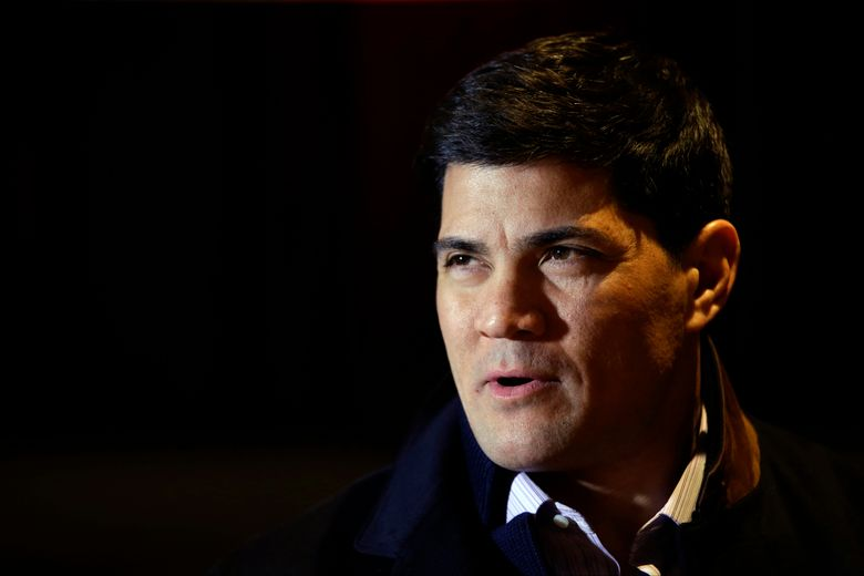 """FILE – In this Jan. 29, 2014, file photo, Tedy Bruschi speaks during an interview at the NFL Super Bowl XLVIII media center in New York. Former New England Patriots linebacker and current ESPN analyst Tedy Bruschi is recovering in a Massachusetts hospital after suffering a second stroke. His family says in a statement the 46-year-old suffered the stroke Thursday and immediately recognized the warning signs of arm weakness, face drooping and speech difficulties. Bruschi was admitted to Sturdy Memorial Hospital in Attleboro, where his family said Friday he was """"recovering well.""""(AP Photo/Matt Slocum, File)"""