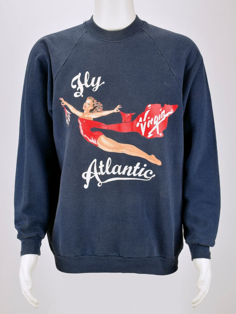 This baggy Virgin Atlantic sweatshirt worn by Princess Diana is expected to fetch several thousand dollars at auction.  (Sarina Carlos/RR Auction via AP)