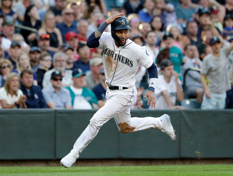 Mariners shortstop J.P. Crawford scores July 20 against the Los Angeles Angels at T-Mobile Park. (Elaine Thompson / The Associated Press)