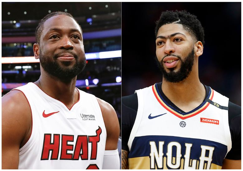 This combination of photos shows Miami Heat guard Dwyane Wade after an NBA basketball game against the New York Knicks in New York on March 30, 2019, left, and New Orleans Pelicans forward Anthony Davis during an NBA basketball game in New Orleans on March 16, 2019. Video game company 2K Sports announced that Davis will be the cover athlete for the NBA 2K20's standard and deluxe editions. Three-time NBA champion Dwyane Wade, who recently retired, will cover the legend edition. (AP Photo/Nicole Sweet, left, and Tyler Kaufman)