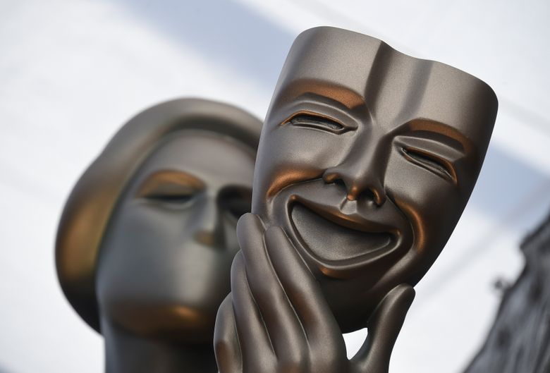 FILE – This Jan. 27, 2019 file photo shows The Actor statue on the red carpet at the 25th annual Screen Actors Guild Awards in Los Angeles. The 26th annual Screen Actors Guild Awards will be held on Jan. 19, 2020, a week earlier than planned, to avoid airing at the same time as the Grammy Awards. (Photo by Jordan Strauss/Invision/AP, File)