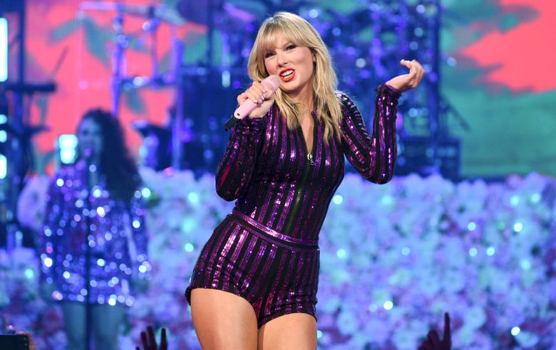 In this July 10, 2019 file photograph, singer Taylor Swift performs at Amazon Music's Prime Day concert at the Hammerstein Ballroom in New York City. Police in Rhode Island have arrested an Iowa man they say intended to visit Swift's beachfront mansion in the state and was carrying a backpack containing a baseball bat and items commonly used in burglaries. (Photo by Evan Agostini/Invision/AP)
