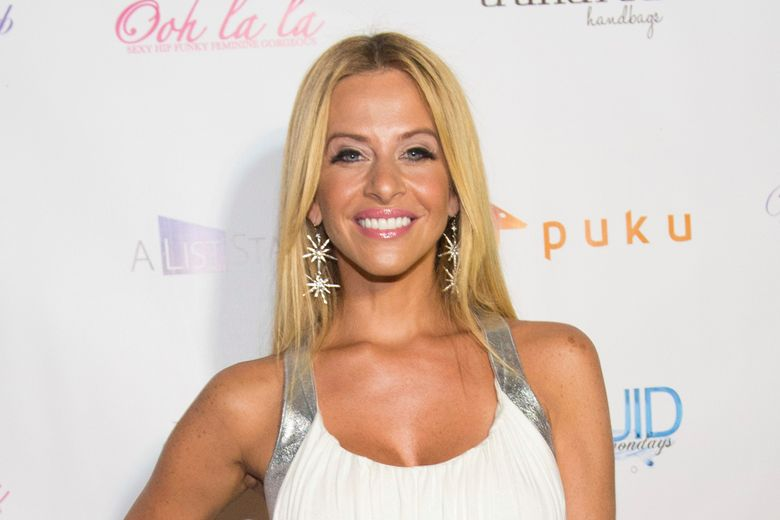 """FILE – In this July 21, 2014, file photo, Dina Manzo attends """"The Real Housewives of New Jersey"""" White Party at the Woodbury Country Club on Monday, in New York. James Mainello, allegedly involved in the home invasion of the former """"Real Housewives of New Jersey"""" cast member, has been indicted on Monday, July 22, 2019, on several counts, including robbery and aggravated assault. (Photo by Scott Roth/Invision/AP, File)"""