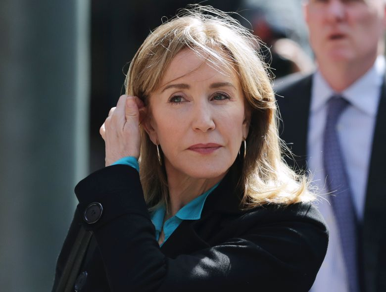 """FILE – In this April 3, 2019 file photo, actress Felicity Huffman arrives at federal court in Boston to face charges in a nationwide college admissions bribery scandal.  Huffman's co-stars in a new Netflix movie say they found her remorseful about her role in a college admissions scandal.  Huffman didn't meet reporters to promote the film """"Otherhood,"""" which premieres on Netflix on Aug. 2. She pleaded guilty in May to paying $15,000 to a college admissions consultant to have a procter correct her daughter's answers on the SAT. (AP Photo/Charles Krupa, File)"""