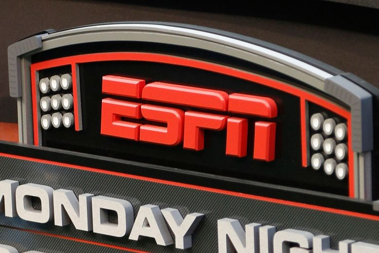 FILE – This Sept. 16, 2013, file photo shows the ESPN logo prior to an NFL football game between the Cincinnati Bengals and the Pittsburgh Steelers, in Cincinnati. ESPN is reminding employees of the network's policy to avoid talking about politics after radio talk show host Dan Le Batard criticized President Donald Trump and his recent racist comments and ESPN itself on the air this week. (AP Photo/David Kohl, File)