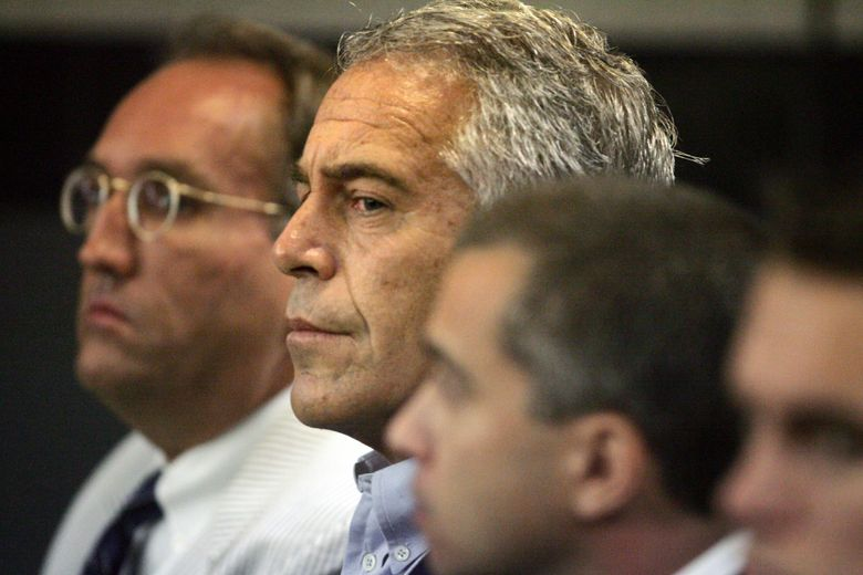 FILE – In this July 30, 2008 file photo, Jeffrey Epstein, center, appears in court in West Palm Beach, Fla. The wealthy financier pleaded not guilty in federal court in New York on Monday, July 8, 2019, to sex trafficking charges following his arrest over the weekend. Epstein will have to remain behind bars until his bail hearing on July 15. (Uma Sanghvi/Palm Beach Post via AP, File)