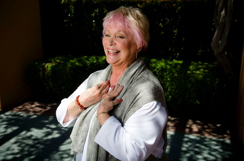 In this June 3, 2014 photo, Disney legend Russi Taylor stands amidst the long shadows at the Disney Legend Plaza at Disney Studios in Burbank, Calif. Taylor, an actress who for more than three decades gave voice to Minnie Mouse, has died on Friday, July 26, 2019, at age 75. Walt Disney Co. chairman Bob Iger announced Taylor's death in a statement Saturday. (Gina Ferazzi/Los Angeles Times via AP)