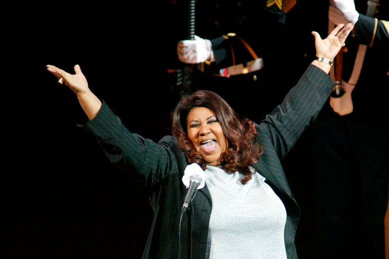 FILE – In this June 15, 2004 file photo, singer Aretha Franklin sings the national anthem before the start of game 5 of the NBA Finals between the Detroit Pistons and the Los Angeles Lakers in Auburn Hills, Mich. Michigan Gov. Gretchen Whitmer signed legislation Monday, July, 8, 2019, honoring the late Queen of Soul with a highway designation. (AP Photo/Al Goldis, File)
