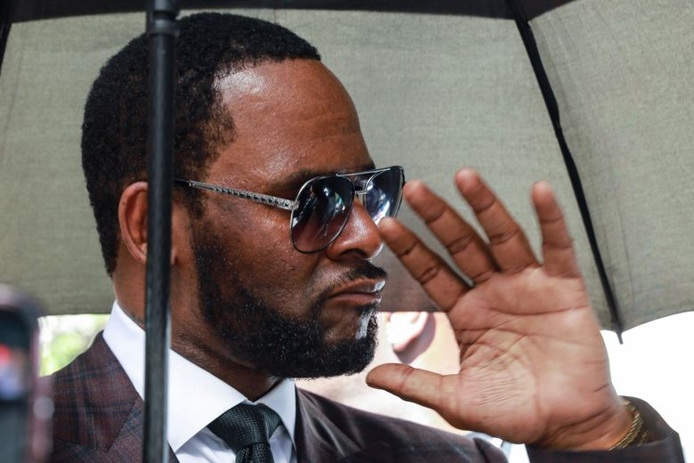 """FILE – In this June 26, 2019, file photo, Musician R. Kelly departs from the Leighton Criminal Court building after a status hearing in his criminal sexual abuse trial in Chicago. Lawyers for Kelly are asking a judge in Chicago to fine and jail his ex-wife for breaking a confidentiality clause in their divorce agreement. The Chicago Sun-Times reports that Kelly's attorney Steve Greenberg said in a Tuesday, July 2, 2019, filing that Andrea Kelly appeared """"on countless media outlets disparaging Robert Kelly and making accusations and charges."""" (AP Photo/Amr Alfiky, File)"""