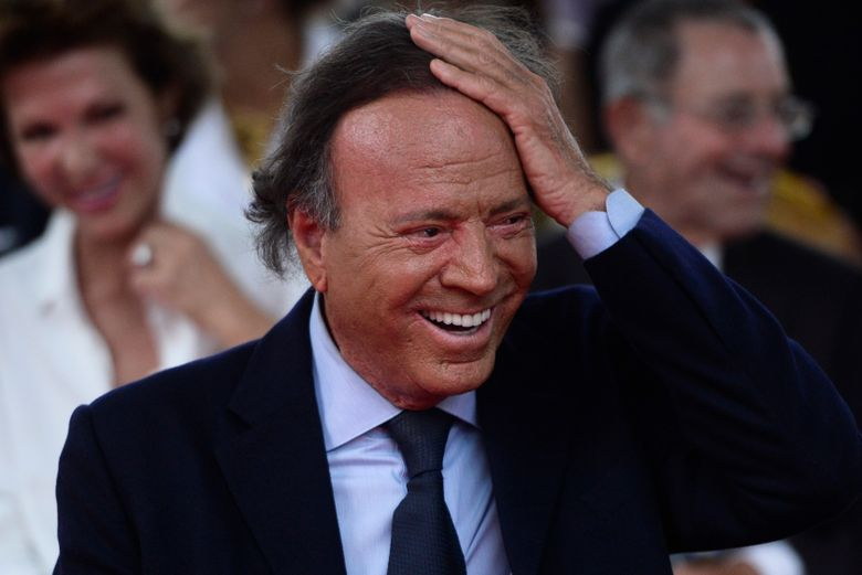 FILE – In this Sept. 29, 2016 file photo, Spain's singer Julio Iglesias smiles during his star unveiling ceremony at the Walk of Fame in San Juan, Puerto Rico. A Spanish judge has ruled on Wednesday, July 10, 2019 that there exists sufficient evidence to determine that a 43-year-old Spanish man is the biological son of Julio Iglesias, despite the singer's refusal to submit to genetic testing. The judge said the famous crooner's refusal to have a DNA test, along with other evidence, is enough to rule in favor of the paternity suit brought by Javier Sanchez. (AP Photo/Carlos Giusti, File)