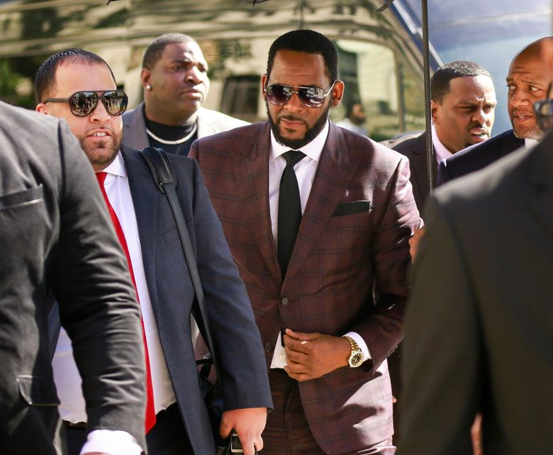 """FILE – In this June 26, 2019, file photo, R&B singer R. Kelly, center, arrives at the Leighton Criminal Court building for an arraignment on sex-related felonies in Chicago. Lifetime announced Tuesday, July 23, that it has ordered """"Surviving R. Kelly: The Aftermath,"""" a four-part series interviewing new survivors and experts. (AP Photo/Amr Alfiky, File)"""