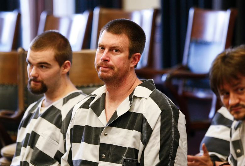 FILE – In this May 8, 2012, file photo, Ryan Leaf, center, sits in a Cascade County courtroom in Great Falls, Mont. Ryan Leaf spent most of his time in prison alone and angry until a military veteran persuaded the former No. 2 overall NFL draft pick to stop self-loathing long enough to help fellow inmates learn to read. Now the once-star quarterback who is widely considered the biggest bust in league history is helping former players adapt to retirement and trying to make sure they cope far better than he did. (Larry Beckner/The Great Falls Tribune via AP, File)
