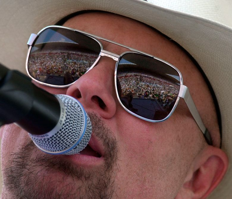 FILE – In this June 12, 2000 file photo Country music fans are reflected in the glasses of Southern rock group Confederate Railroad lead singer Danny Shirley during a concert in Nashville, Tenn. Confederate Railroad says it has been removed from the DuQuoin State Fair's Grandstand lineup because of its name. Frontman Danny Shirley said in a statement Tuesday, June 9, 2019 that the band is disappointed but thanked fans for their support. The group was scheduled to play Aug. 27, 2019. (AP Photo/Mark Humphrey)