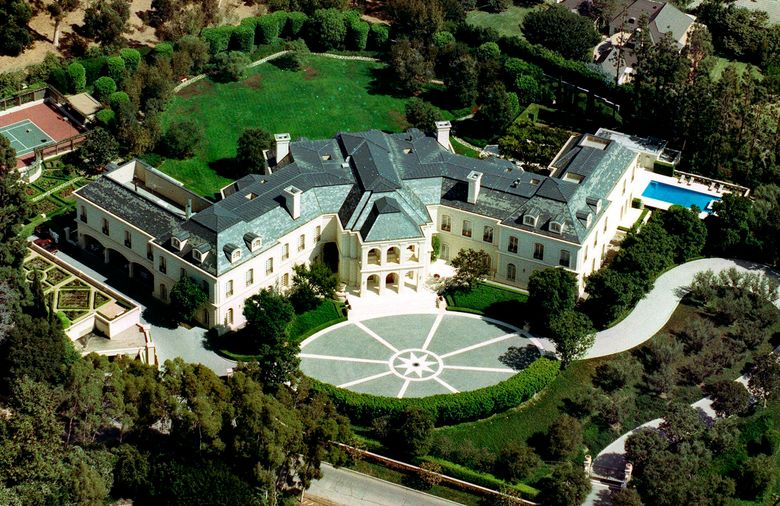 FILE – In this Sept. 1993, file photo, the home of Aaron Spelling is seen in the Holmby Hills section of Los Angeles. The gigantic Los Angeles mansion built for the late producer Aaron Spelling and his widow in 1991, has been sold for $119.75 million. The Los Angeles Times says the sale that closed Tuesday, July 2, 2019, is the highest home price in Los Angeles County history. After his death in 2006, his widow, Candy, sold the mansion for $85 million to Petra Ecclestone, daughter of Formula One billionaire Bernie Ecclestone. (AP Photo/Mark J. Terrill, File)