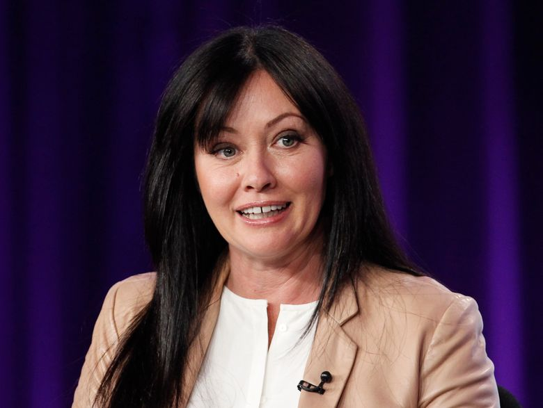 """FILE – In this Jan. 14, 2012, file photo, Shannen Doherty participates in a panel for the television show """"Shannen Says"""" on WE tv during the AMC Networks portion of the Television Critics Association Winter Press Tour in Pasadena, Calif. Doherty will guest star in the season four premiere of """"Riverdale,"""" which is set to honor Luke Perry. The show's executive producer, Roberto Aguirre-Sacasa, made the announcement Sunday at Comic-Con in San Diego. (AP Photo/Danny Moloshok, File)"""