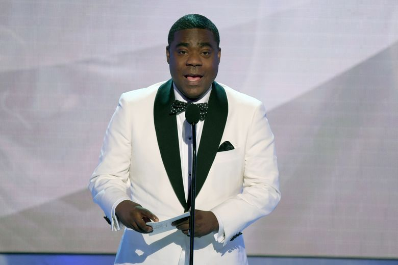 """FILE – In this Jan. 27, 2019, file photo, Tracy Morgan presents the award for outstanding performance by an ensemble in a comedy series at the 25th annual Screen Actors Guild Awards in Los Angeles. For Tracy Morgan, hosting The ESPYs is personal. It's not just another gig to the comedian. The star of TBS' """"The Last O.G."""" presides over Wednesday's, July 10, 2019, show honoring the past year's top athletes, performances and achievements airing live on ABC from Microsoft Theater in Los Angeles. """"The main reason I really wanted to do it is the fight against cancer,"""" Morgan said in a recent phone interview, explaining that his grandparents and former wife Sabina died of the disease. """"(Photo by Richard Shotwell/Invision/AP, File)"""