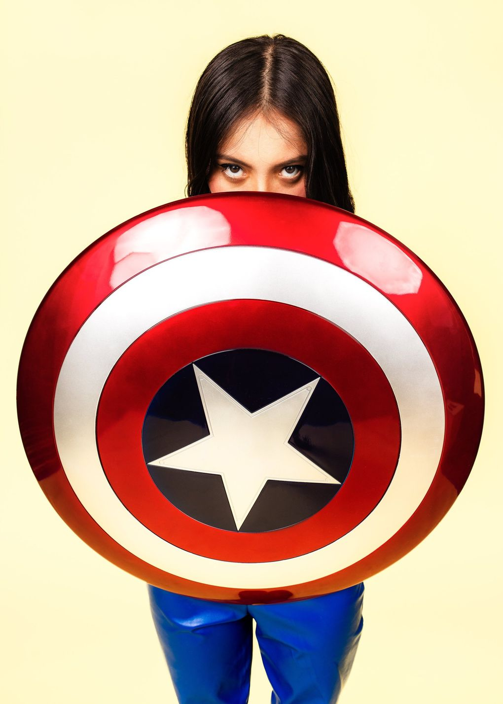 """Giselle Lopez, 18, a marketing student working two jobs and a future filmmaker, says in the exhibit: """"I literally have $2 in my bank account and I'm working two jobs to try and survive with no one. Captain America was my favorite superhero when I was little. It's kind of ironic because he's super patriotic and … yeah, I can't really relate to him right now."""" (Nate Gowdy)"""