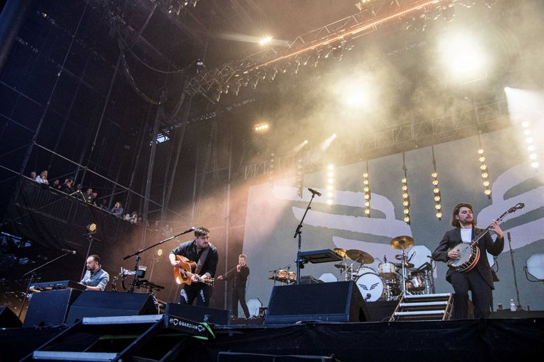 Mumford & Sons perform at the BottleRock Napa Valley Music Festival in Napa, California. They'll perform at the Gorge Amphitheatre on Friday, Aug. 9. (Amy Harris / Invision / The Associated Press)